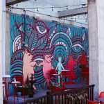 Dancing Pigs Mural at The Internation Tap House Patio Louisville - Main and Clay Mural - Louisville Murals