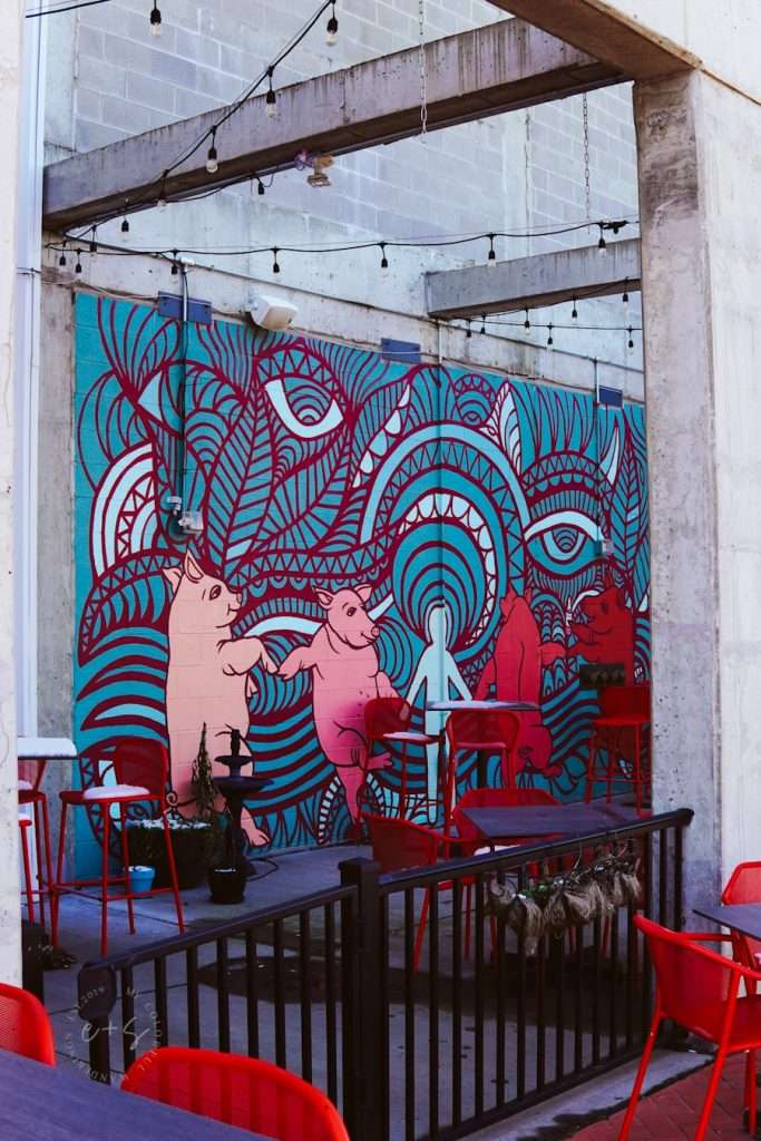 Dancing Pigs Mural at The Internation Tap House Patio Louisville - Main and Clay Mural - Louisville Murals - The International tap House Louisville, Ky- Louisville, KY, United States - Louisville Rooftop Bars - heated patios in louisville, Louisville's Best Patios, Louisville Outdoor Dining During Covid, Outdoor Seating Restaurants in Louisville, Best patio Restaurants in Louisville, Best Restaurants in Louisville