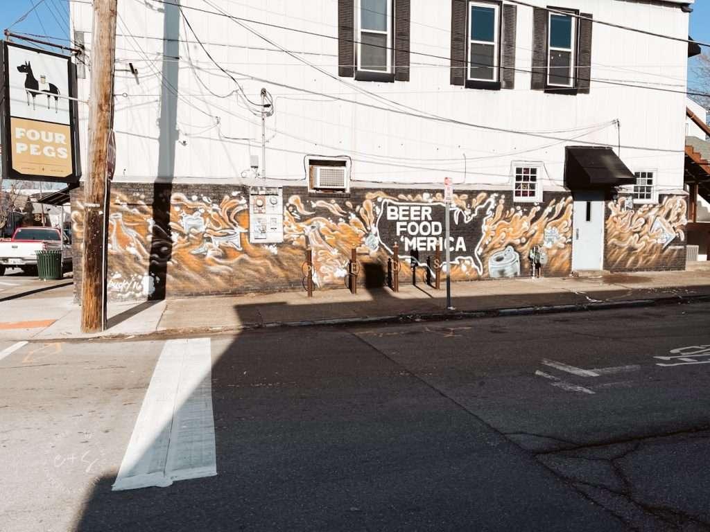 beer food merica mural at four pegs louisville kentucky