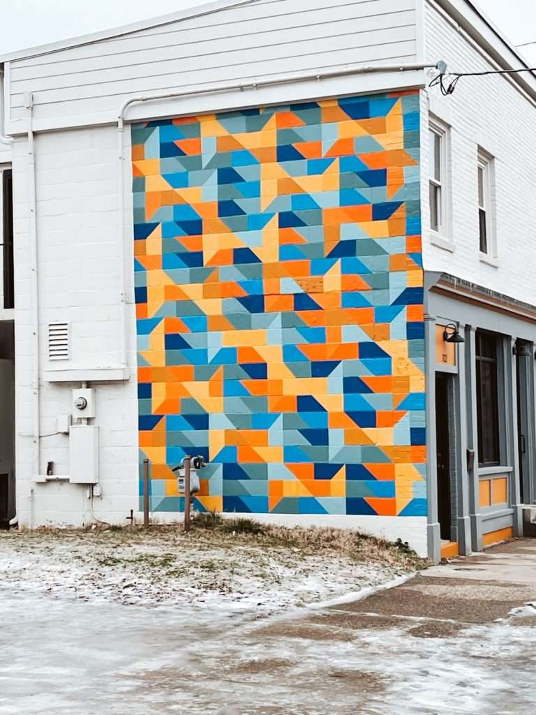 Colorful Triangles on the Side of Sidekick Marketing louisville kentucky Mural
