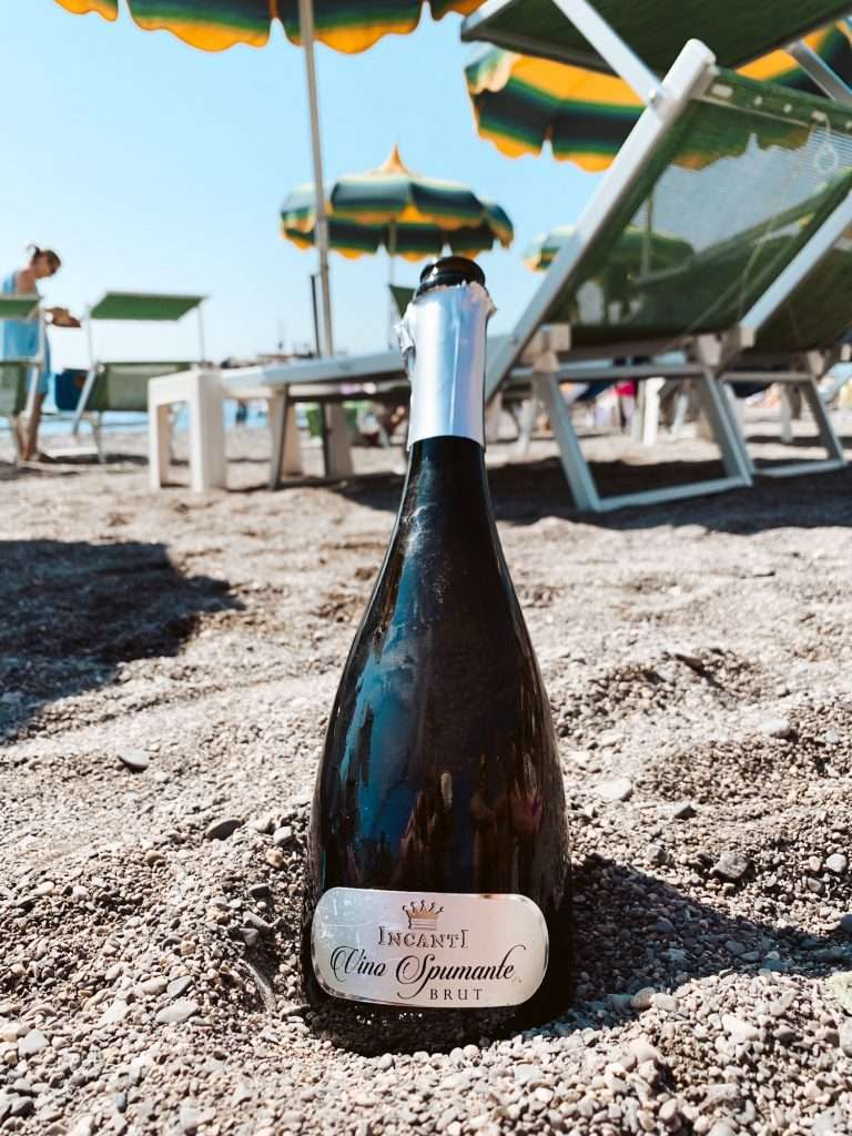 Drinking champagne on the beach